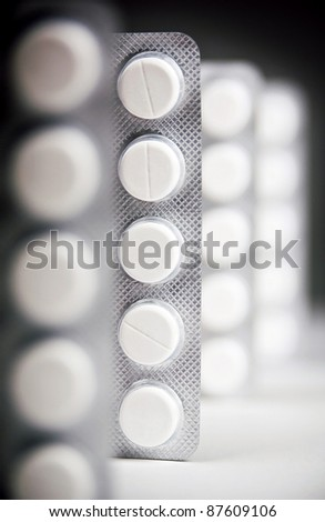 Packs of generic medicine with dark lighting
