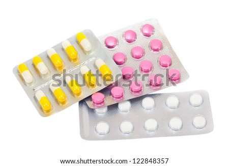 Packs of pills isolated on white background