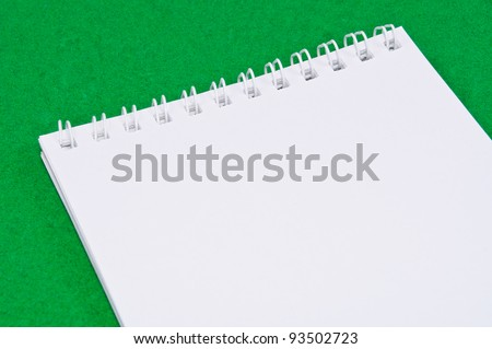Pad of paper to take notes. Photo on a colored background