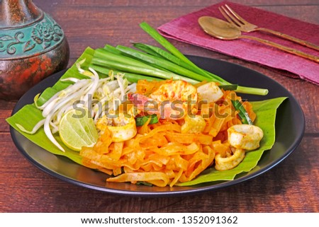 Pad Thai (or Phad Thai) : Pad Thai Chaiya  is a famous recipe of stir-fried rice noodle dish from Surat Thani, Thailand with differential by added coconut milk with tamarind sauce. #1352091362