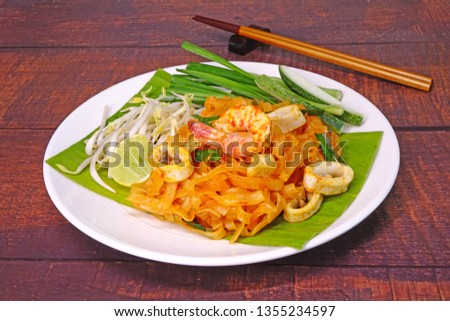 Pad Thai (or Phad Thai) : Pad Thai Chaiya  is a famous recipe of stir-fried rice noodle dish from Surat Thani, Thailand with differential by added coconut milk with tamarind sauce. #1355234597