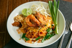 Pad Thai placed on a wooden table