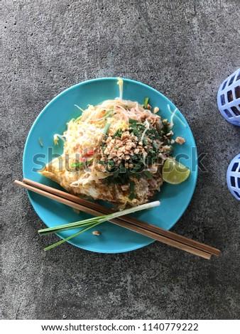Pad thai.  Thai is a thai food #1140779222