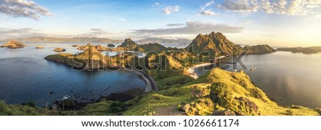 Padar island, Indonesia. Beautiful panorama view of the island with mountain and beach in sunrise. #1026661174