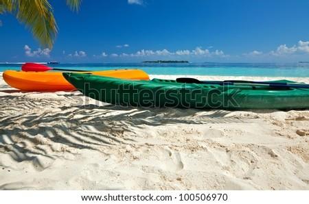 Paddle boats are on sandy beach, Maldives - stock photo