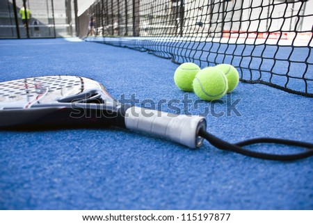 Paddle objects on blue turf