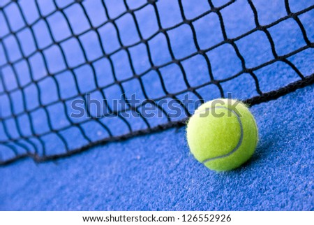 Paddle or tennis Ball in real court