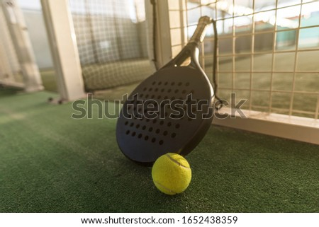 Paddle tennis image of outdoors court, racket, net and ball Сток-фото ©
