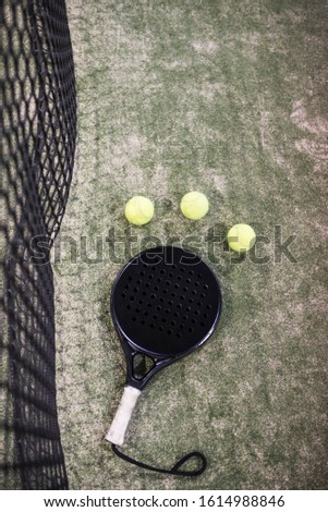 Paddle tennis net, racket and balls on turf Сток-фото ©