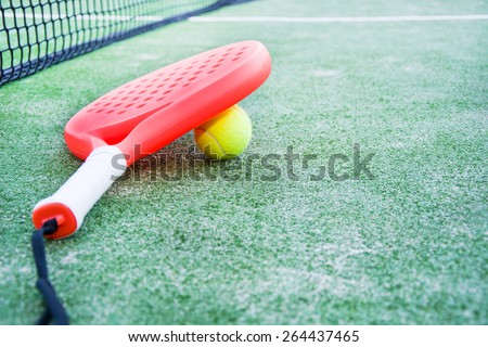 paddle tennis racket and ball in paddle tennis field