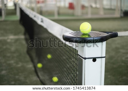 Paddle tennis racket and balls on court still life Сток-фото ©