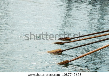 Paddles on the water. Rowing. A rowing boat. There is room for text. #1087747628
