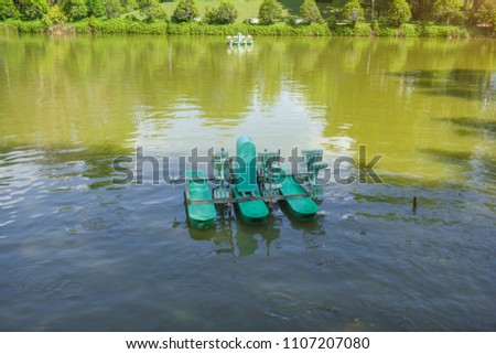 Paddlewheel aerators in a water pond, Bueng Kan Province, Thailand #1107207080