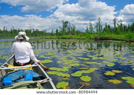Paddling through the lily pads on Crooked Lake in the Boundary waters