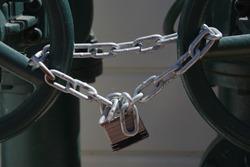 Padlock and heavy chain locking main water valves