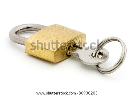 Padlock and key over white