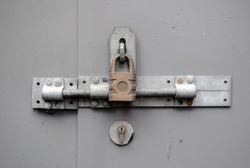 Padlock and Metal Hasp in Close Up