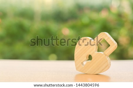 Padlock in the shape of a heart. The secret of relationships and the rules of a strong family.. Strong love affair. Secrets, rumors and gossip. The concept of female intimate health. Heart health
