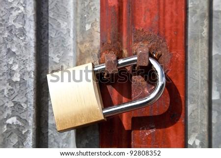 padlock on a gate metal