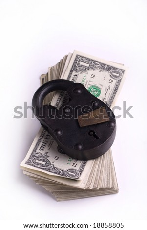 padlock on a stack of cash