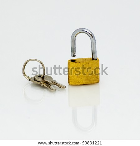 Padlock on a white background with a reflection on the floor