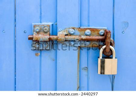 Padlock on brightly painted door