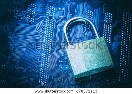 Padlock on computer motherboard. Internet data privacy information security concept. Cyber crime concept. #678371113