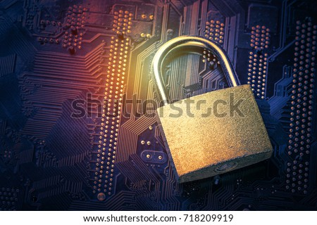 Padlock on computer motherboard. Internet data privacy information security concept. Toned image - Shutterstock ID 718209919
