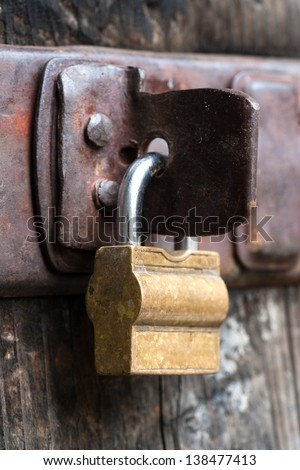 padlock on old barn