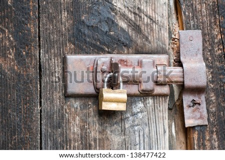 padlock on old barn