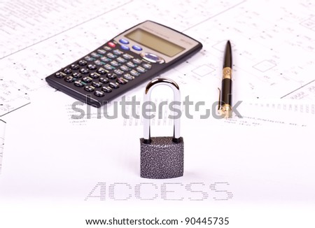 Padlock, pen, calculator and inscription ACCESS of zeros and ones