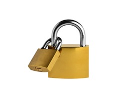 PADLOCK. Two linked yellow metallic padlocks on white background. Clipping Path.