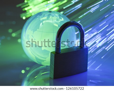 Padlock with crystal globe - stock photo