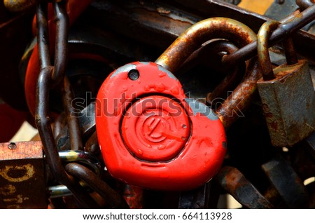 Padlocks are hanging on a fence that hanged lovers #664113928