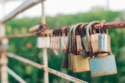 padlocks attached to a bridge , Rusted padlock