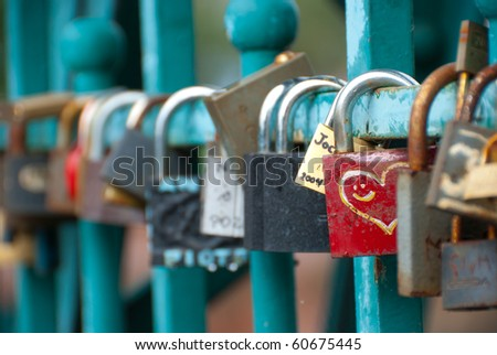 Padlocks hanging on Tumski bridge in Wroclaw, Poland