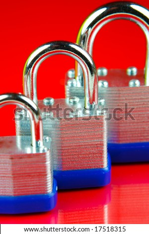 Padlocks isolated against a red background