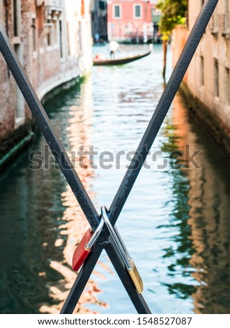 Padlocks of lovers placed on the bridge in Venice #1548527087