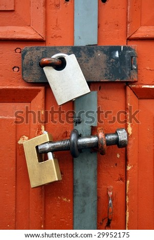 Padlocks on bright red door