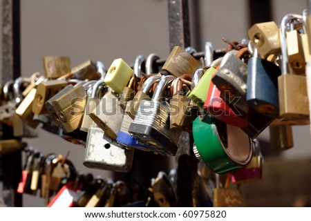 Padlocks on fence in Prague, symbol of love