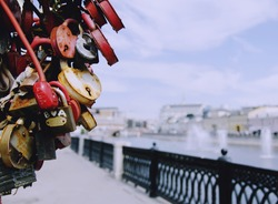 padlocks with the names of loved ones on the waterfront, selective focus