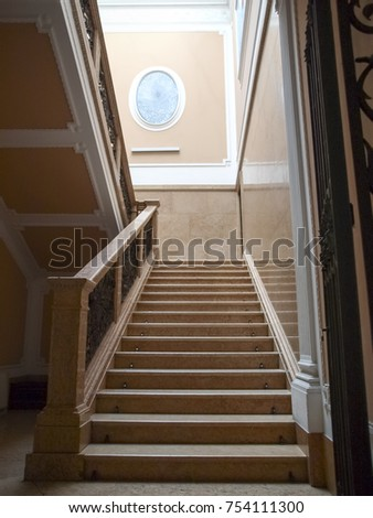 Padova, Italy - May 16, 2016: Staircase in an old house in the historic city center #754111300