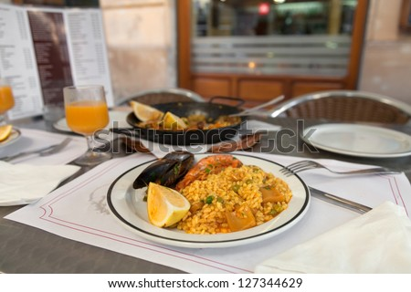 Paella on the plate in street cafe of Barcelona, Spain