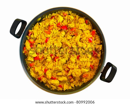 Paella with chicken in a pan