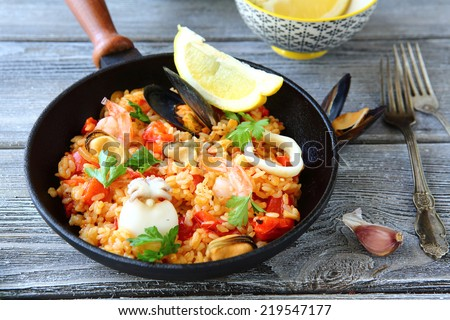 Paella with rice and seafood, delicious food #219547177