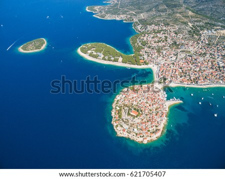 PAG, CROATIA - AUGUST 30, 2014: Aerial view of beach and clubs at popular Zrce beach #621705407