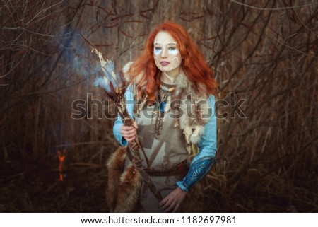 Pagan woman is a shaman during a witchcraft ritual. #1182697981