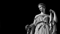 Paganism in Ancient Times. Roman or Greek goddess neoclassical marble statue, erected in the 19th century in Rome hoistoric center (Black and White with copy space)