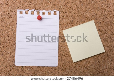 Page from a notepad stuck to a cork noticeboard