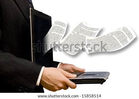 page of a book flying out of a laptop screen, held by a businessman